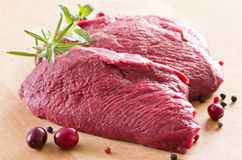 Raw Beef Steaks. As closeup on a wooden board Stock Photos