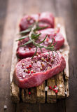 Raw beef steaks stock photo