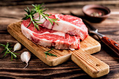 Raw beef steaks. Fresh raw beef steaks on the cutting board Royalty Free Stock Photography
