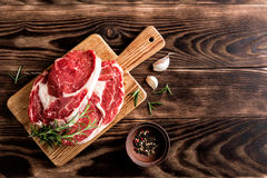 Raw beef steaks. Fresh raw beef steaks on the cutting board Royalty Free Stock Image