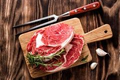 Raw beef steaks. Fresh raw beef steaks on the cutting board Stock Photo
