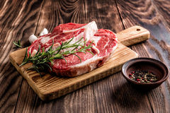 Raw beef steaks. Fresh raw beef steaks on the cutting board Royalty Free Stock Photo