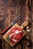 Raw beef steaks. Fresh raw beef steaks on the cutting board Stock Photography