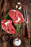 Raw beef steaks. Fresh raw beef steaks on the wooden table Stock Photos