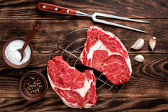 Raw beef steaks. Fresh raw beef steaks on the wooden table Stock Photography