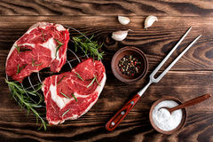 Raw beef steaks. Fresh raw beef steaks on the wooden table Royalty Free Stock Photography