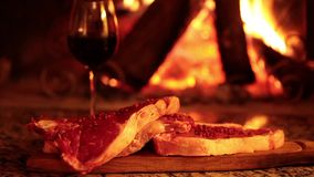 Raw Beef Steaks In Front Of Fireplace stock video footage