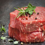 Raw Beef Steaks with Herbs and Spices stock photography