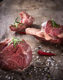 Raw beef steaks and lamb chops Stock Photos