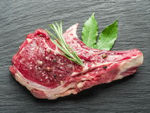 Raw beef steaks with spices. Stock Images