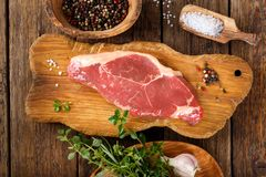 Raw beef striploin steak. Uncooked meat New York strip steak stock image