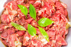 Raw beef. With sweet basil Stock Photos