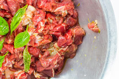 Raw beef. With sweet basil Royalty Free Stock Photo