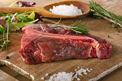 Raw beef t-bone steak on  old wooden table Stock Photo