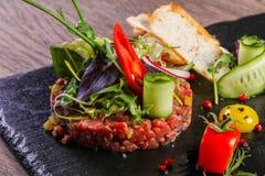 Raw beef tartar. Served quail egg Stock Photo