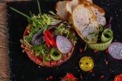 Raw beef tartar. Served quail egg Royalty Free Stock Photo
