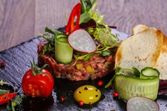 Raw beef tartar. Served quail egg Stock Photography