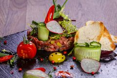 Raw beef tartar. Served quail egg Royalty Free Stock Images