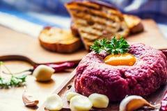 Raw beef .Tasty Steak tartare. Classic steak tartare on wooden b Royalty Free Stock Photo