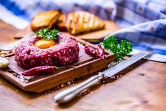 Raw beef .Tasty Steak tartare. Classic steak tartare on wooden b Royalty Free Stock Image