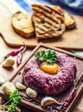 Raw beef .Tasty Steak tartare. Classic steak tartare on wooden b Stock Photography