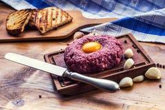 Raw beef .Tasty Steak tartare. Classic steak tartare on wooden b Royalty Free Stock Photos