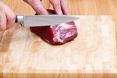 Raw Beef Tenderloin on Cutting Board Stock Photo