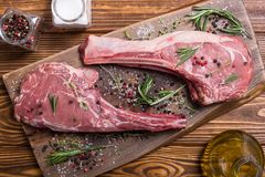 Raw beef tomahawk steak. With ingredient . Raw food background royalty free stock photography