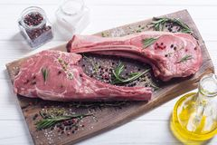 Raw beef tomahawk steak. With ingredient . Raw food background stock image