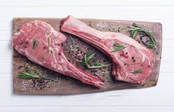 Raw beef tomahawk steak. With ingredient . Raw food background stock photography