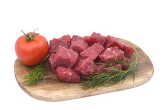Raw beef with tomato and dill Royalty Free Stock Photography