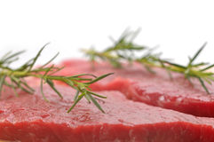 Raw beef with with twig of rosemary Stock Photos