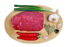 Raw beef with vegetables and spices on the cutting board Royalty Free Stock Image