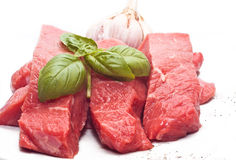 Raw beef on white Royalty Free Stock Photos