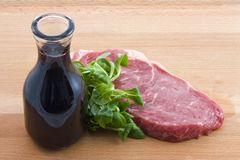 Raw beef and wine Royalty Free Stock Photography
