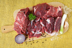 Raw beef on wooden board Stock Photography