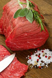Raw beef on wooden table. With rosemary ,sage and salt Royalty Free Stock Photo