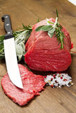 Raw beef on wooden table. With rosemary ,sage and salt Stock Photo