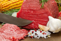Raw beef on wooden table Stock Photo