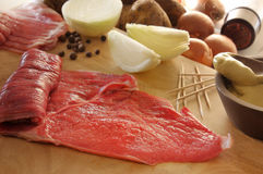 Raw beefsteak. Beefstaek, Onions, Mustard and other ingredients for Rouladen Royalty Free Stock Photography