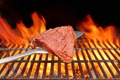 Raw Beefsteak on the Blade Over a Hot BBQ Grill Stock Images