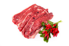 Raw Beefsteaks And Chili Peppers Stock Photo