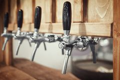 Raw of beer crane macro close-up blurred background. Wooden vintage retro style horizontal image Stock Images