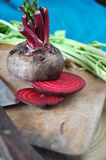 Raw Beetroot Cutting on Board Stock Photography