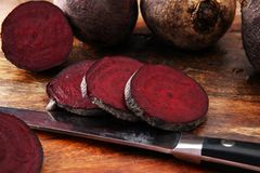 Raw beetroot on a cutting board on wooden background. Raw beetroot on a cutting board on wooden background Stock Photos