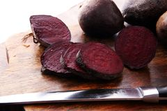 Raw beetroot on a cutting board on wooden background. Raw beetroot on a cutting board on wooden background Royalty Free Stock Photography