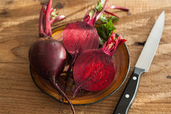 Raw beetroot on wooden background.  Stock Photos