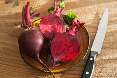 Raw beetroot on wooden background Royalty Free Stock Image