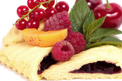 Raw berry and tasty cake Stock Images