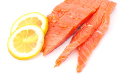Raw big salmon bar with lemon Royalty Free Stock Photography